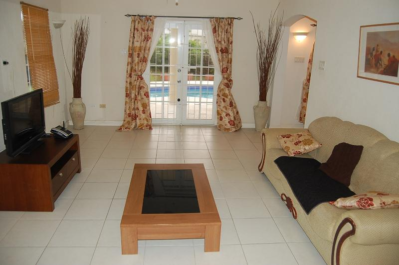 Very Spacious Living Room Area. Furniture and equipment may be different at time of booking