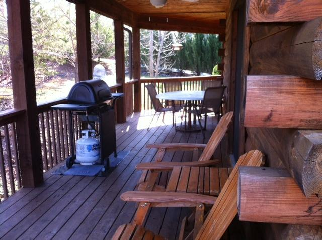 Side porch with gas grill, table and chairs for fun or relaxing