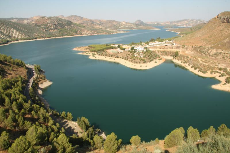 Lake Iznajar with its beach, restaurant, kayaking and pedallos