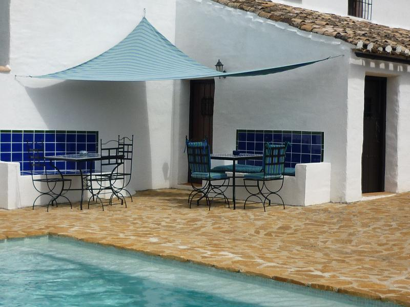 Chairs and tables for eating by the pool