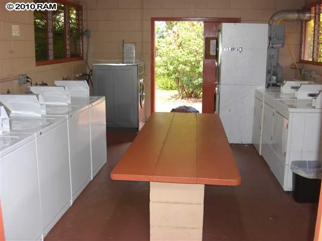 5 Commercial Washers and 5 Commercial Dryers just steps from  condo.
