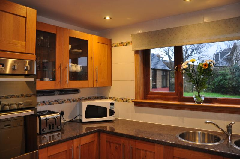 Fully equipped kitchen with double oven.