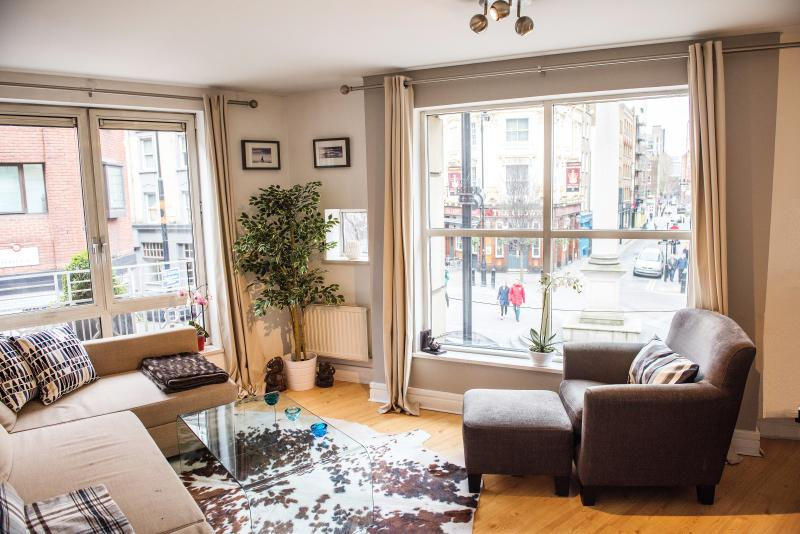 Large lounge with comfortable furniture and amazing view of famous Seven Dials in Covent Garden