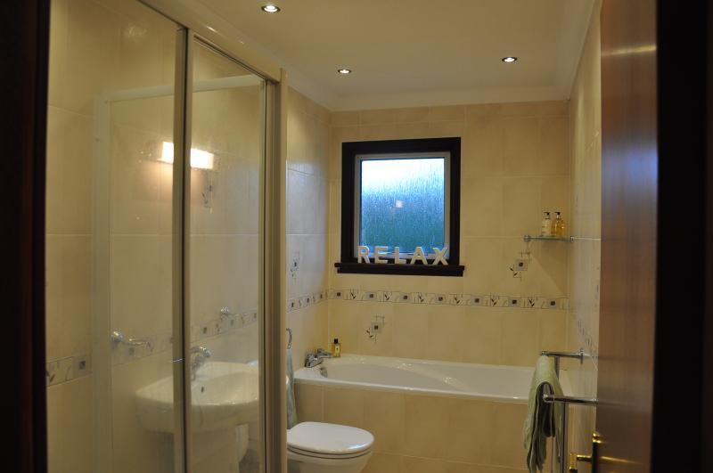 Two bathrooms with bath and showers.