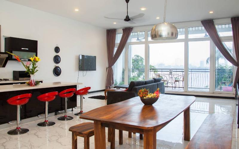 Huge open living/dining/kitchen area leading to beautiful terrace overlooking the river