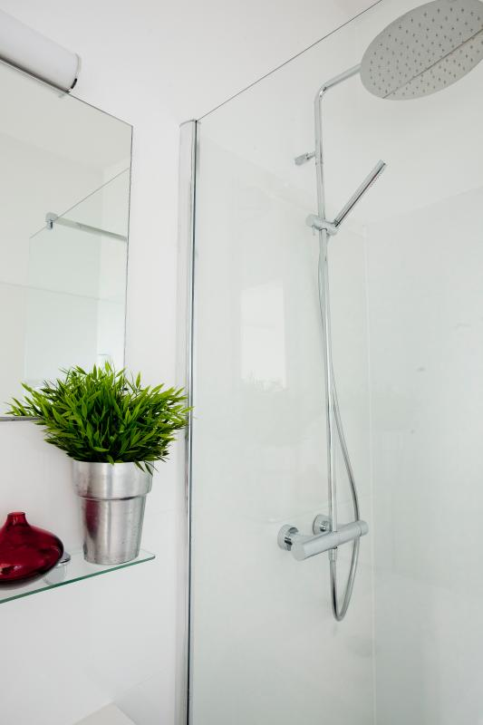 Second bathroom with sink and rainshower at the first floor