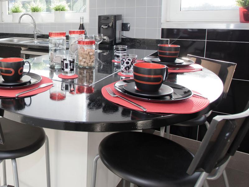 Kitchen with dishwasher, microwave, oven, fridge, washing machine, dryer, toaster and juicer.