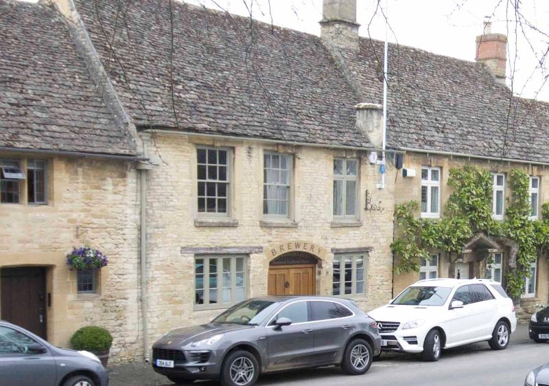 Stunning Grade 2 Listed Cotswold stone converted Brewery with log burner and contemporary courtyard.