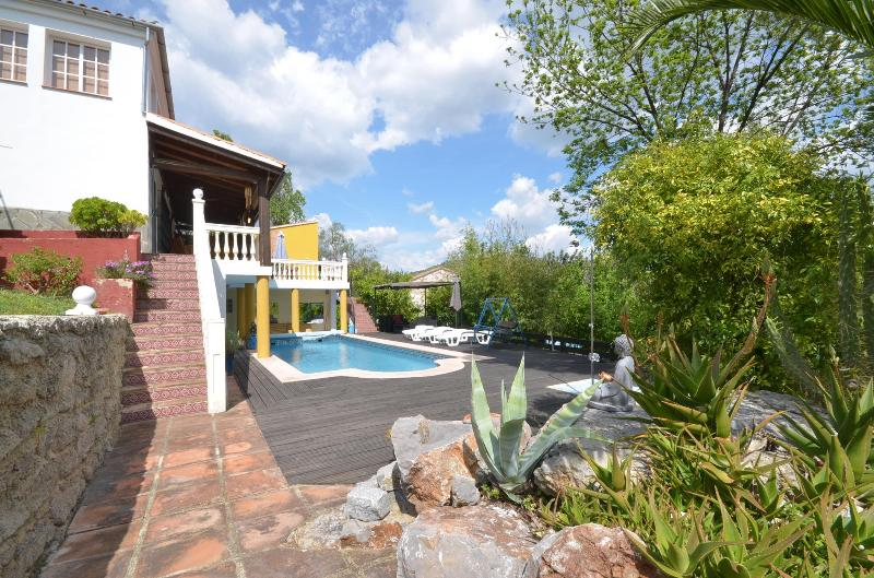 stunning pool with  surrounding  decking area.