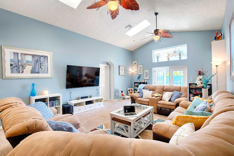 Living area with 70 inch HDTV, Bose Surround Sound and hundreds of DVDs. Complimentary Netflix too.