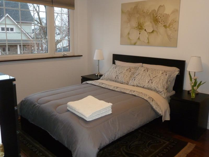 Sunny cozy double room features an extra-large front window.
