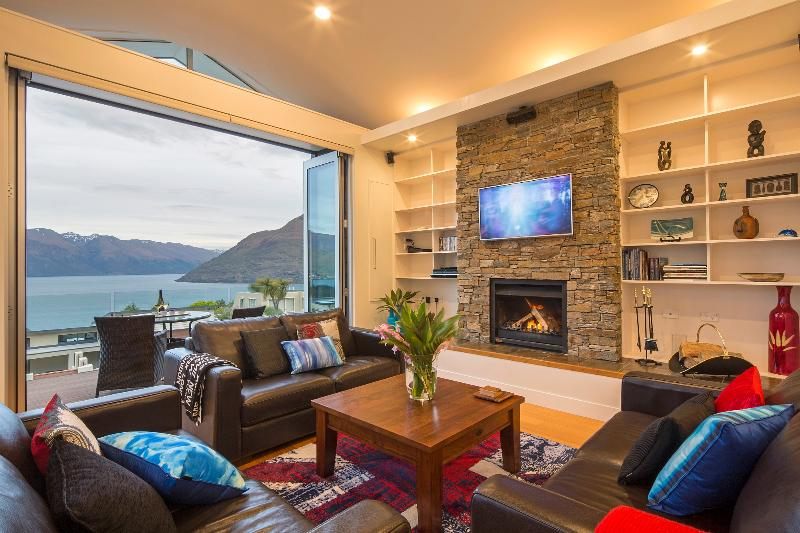 Bi-fold doors, lake views and log fireplace creating the perfect alpine environment