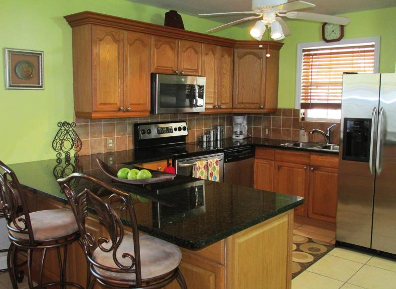 Fully loaded kitchen with stainless steel appliances