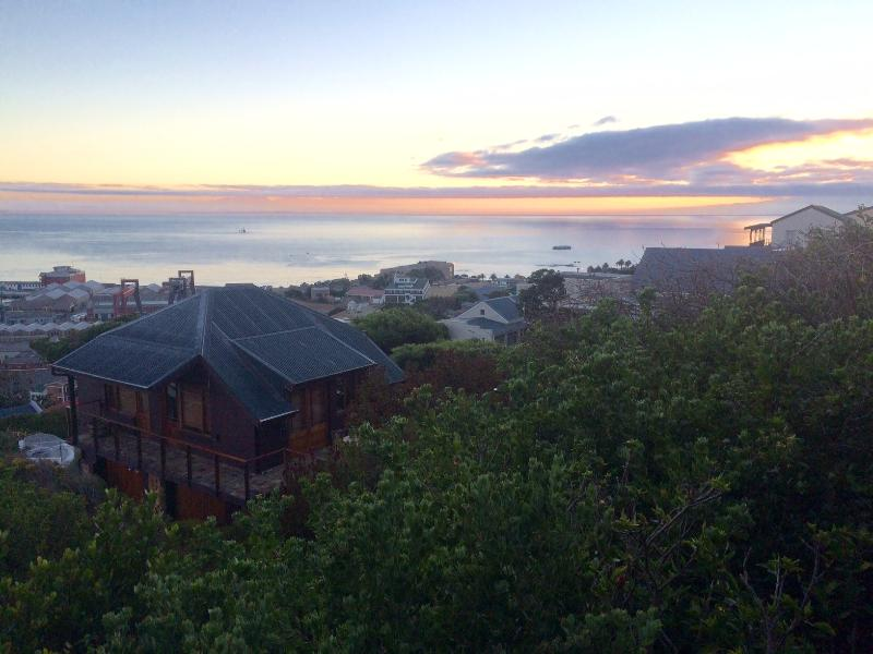 An early morning shot of the cottage with the view of False Bay behind.