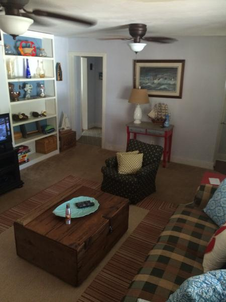 Full pull out sofa, two comfy lounge chairs, double ceiling fans, play station, and board games.