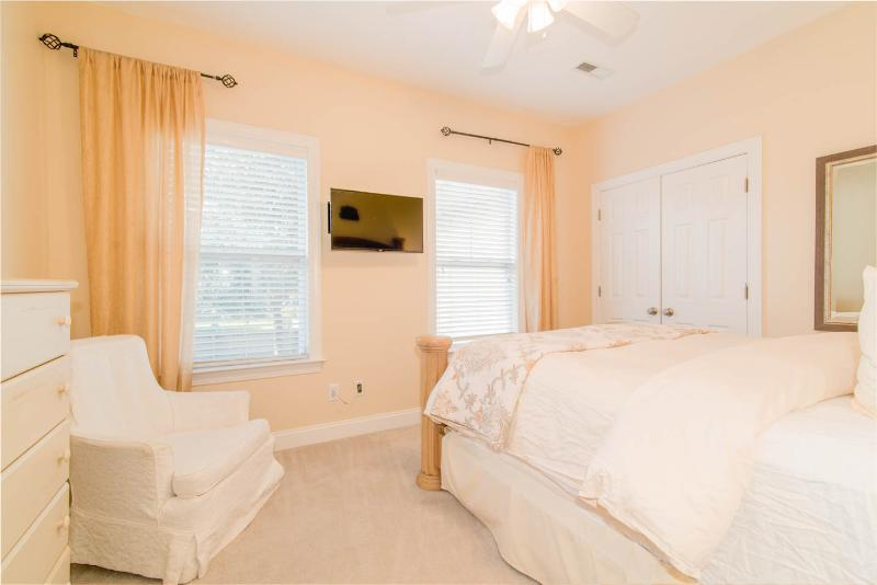 One of the 3 Queen Bedrooms. Each bedroom has an HDTV and Ceiling fan. This BR shares a Bathroom.