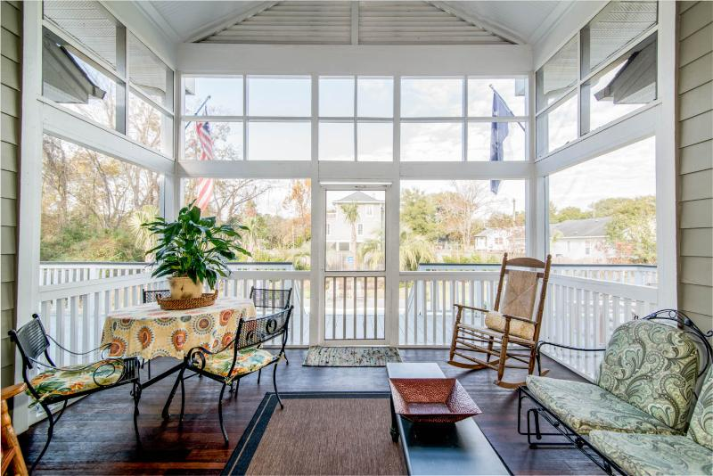 Screened Porch great for groups to enjoy. Overlooking pool. Ceiling fan.