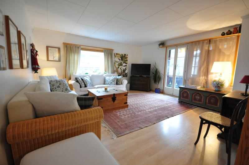 bright spacious living room opens onto sunny south facing balcony