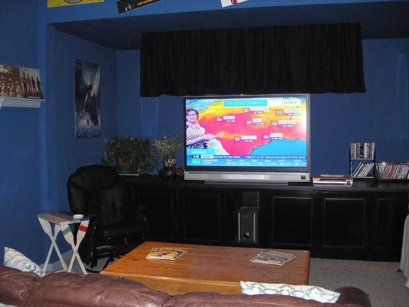 50' Screen TV with surround sound, DVD player, movie library