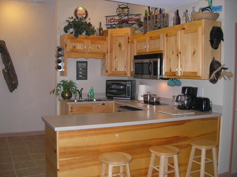 Kitchenette with 2 eye stove top, mini fridge, coffee maker, microwave, toaster, toaster oven