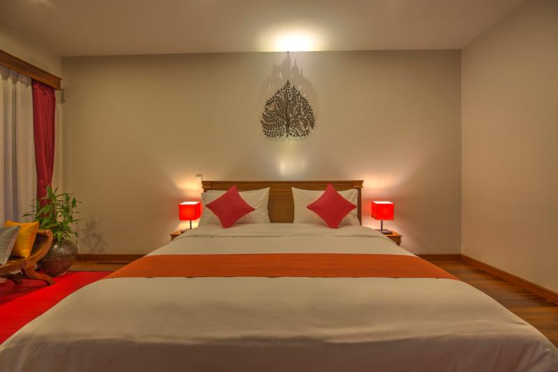 The Red Room with 35 sqm and terrace 25 sqm . Decor is inspired from southern gallery of Angkor Wat