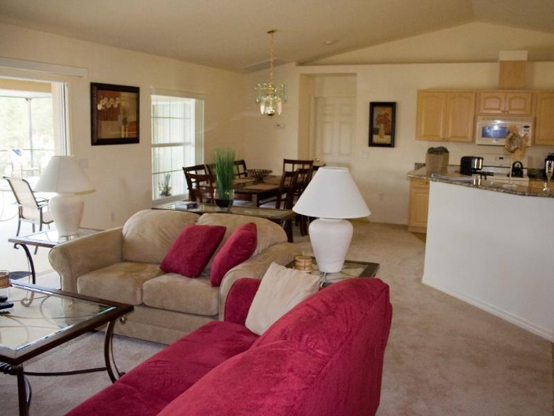 Open plan layout: living and dining area. At the right is the kitchen