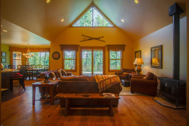 A GREAT ROOM in rustic luxury, peaceful serenity expansive views, natural light, vaulted ceiling