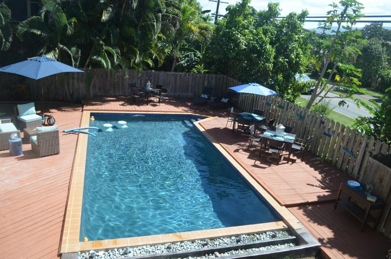 Your own resort!!  The backyard pool.  Seating for 12, lounge seating and even pool stools.