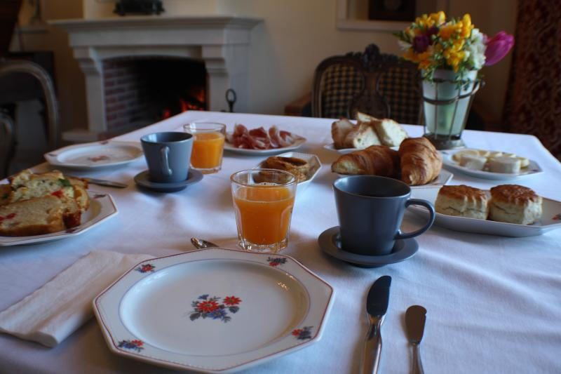 Complementary breakfast served by the fireplace in the wintertime, featuring local specialties