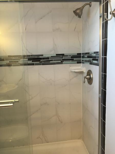 Master bathroom tiled shower.