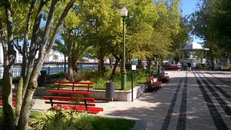 This is the riverside park in Tavira. locals sit in the shade while kids spot turles in the pool.