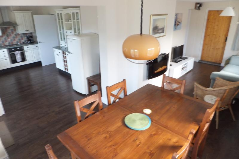 A view of our large L-shaped kitchen / dining/ living room.