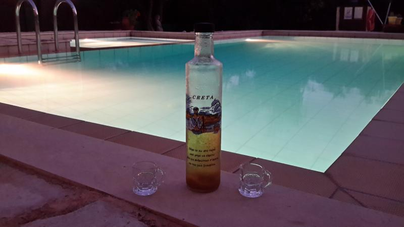 Enjoy a glass of our Honey Raki by the pool.