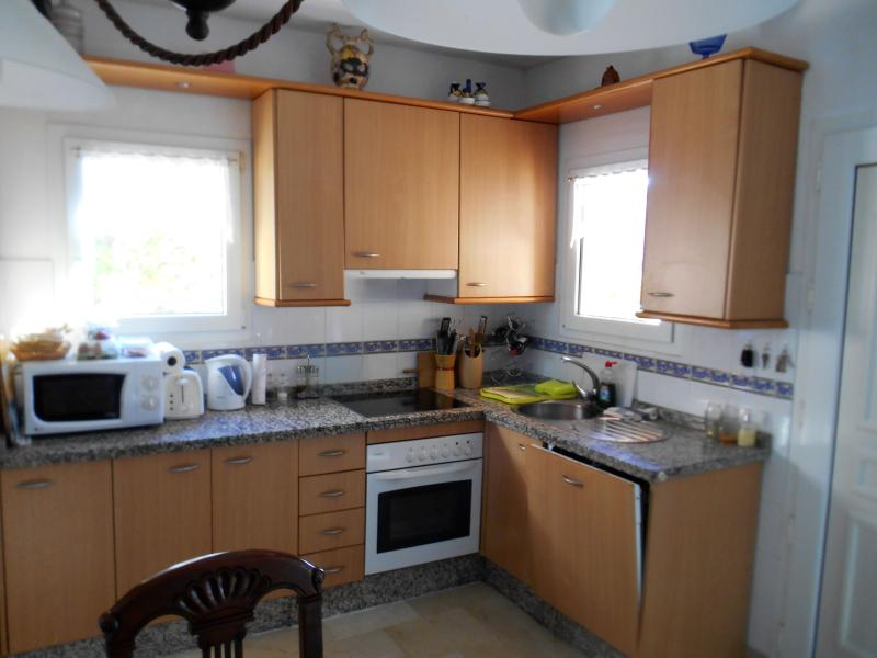 Kitchen, including cooker and dishwasher.