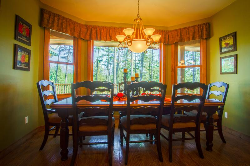 DINING in and enjoying the expansive lake and mountain views; seats 8-10