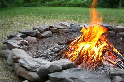FRONT YARD FIRE PIT just steps away for hours of family enjoyment, sharing stories and star gazing