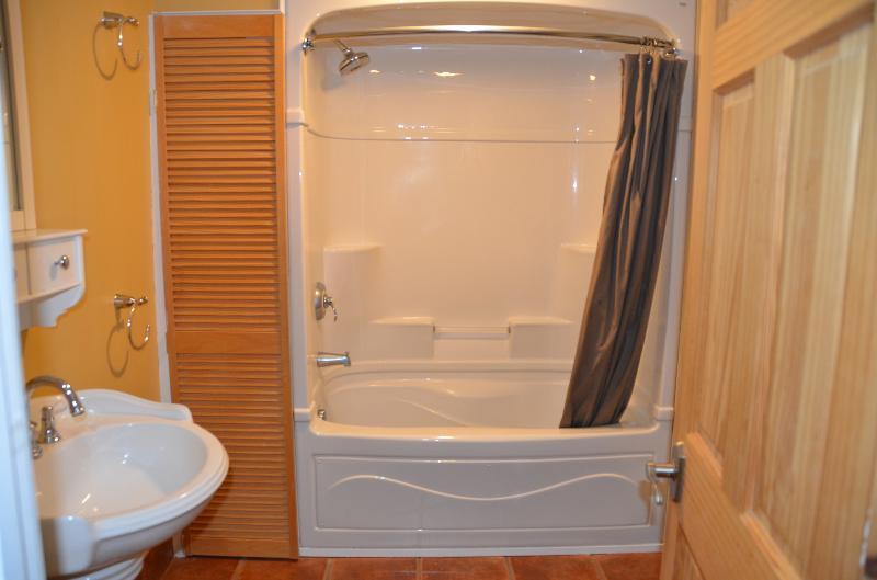 Full bathroom on main floor with Jacuzzi tub.