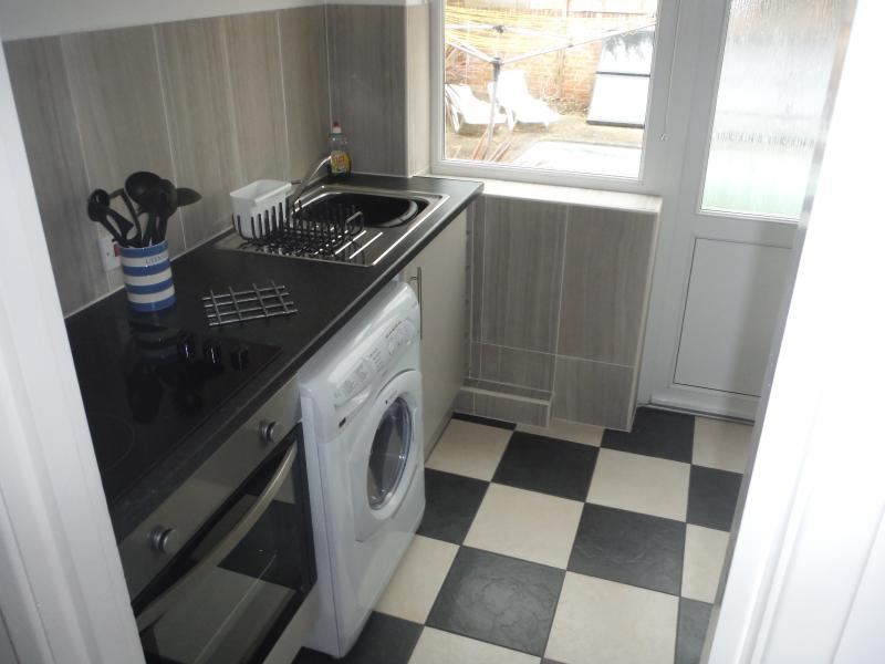 Washer-Drier, single oven with Grill, ceramic Hob.