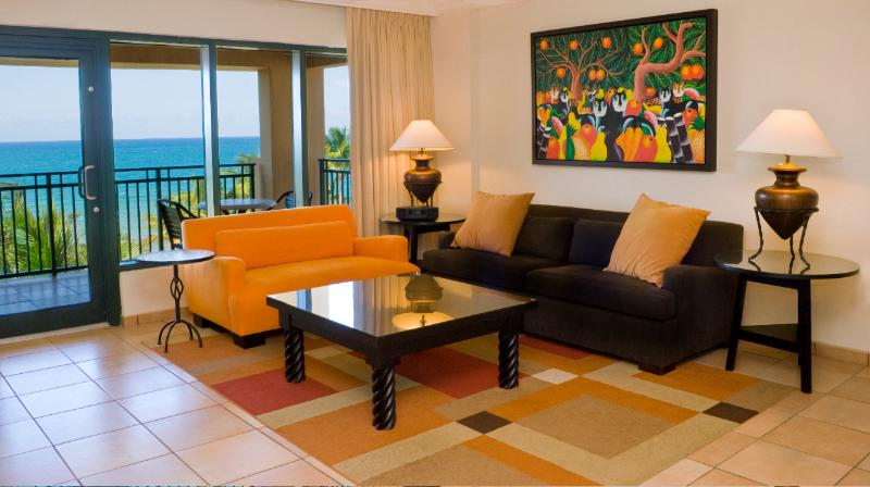 Living room with sofabed and great beach view