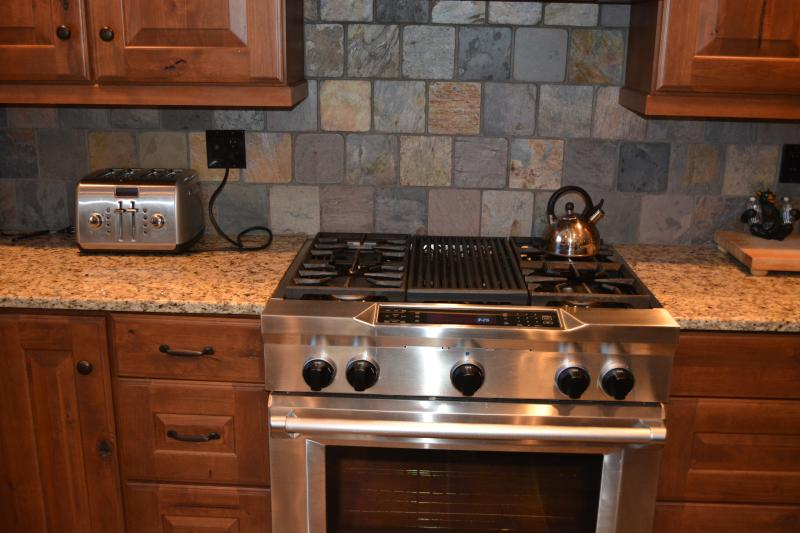 38' Kitchenaid electric oven and gas cooktop with grill.