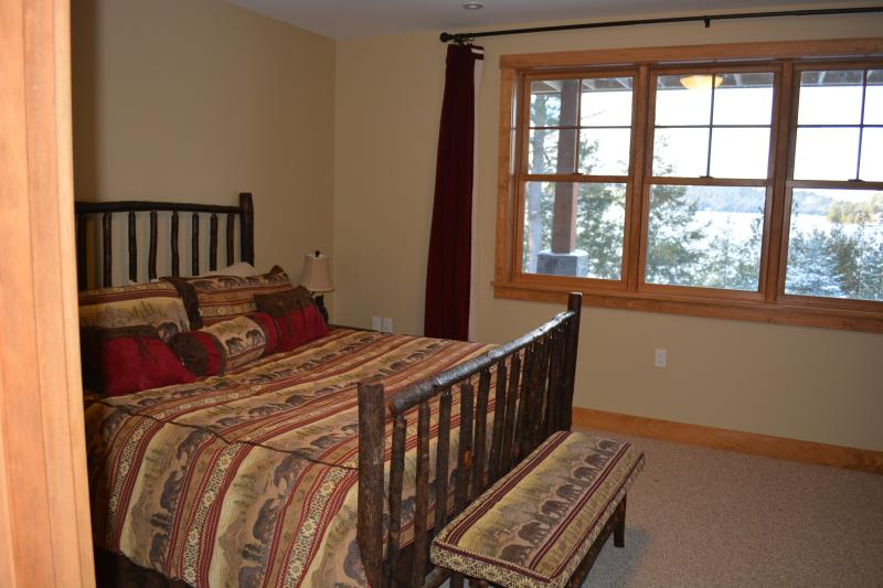 The Bear's Den, king bed and full view of lake.