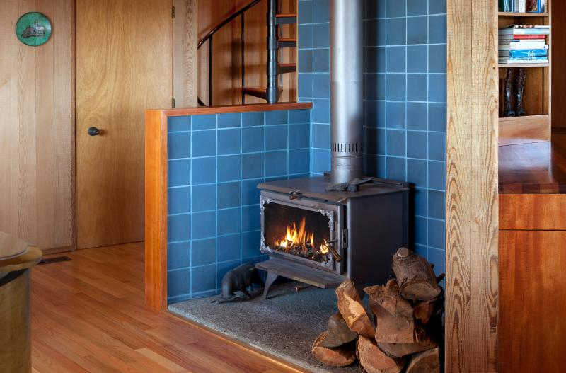 The living room features both a fireplace and a cozy wood-burning stove.