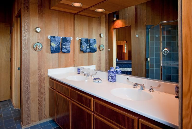 Even the spacious master bath is impressive with Honduran mahogany cabinetry.
