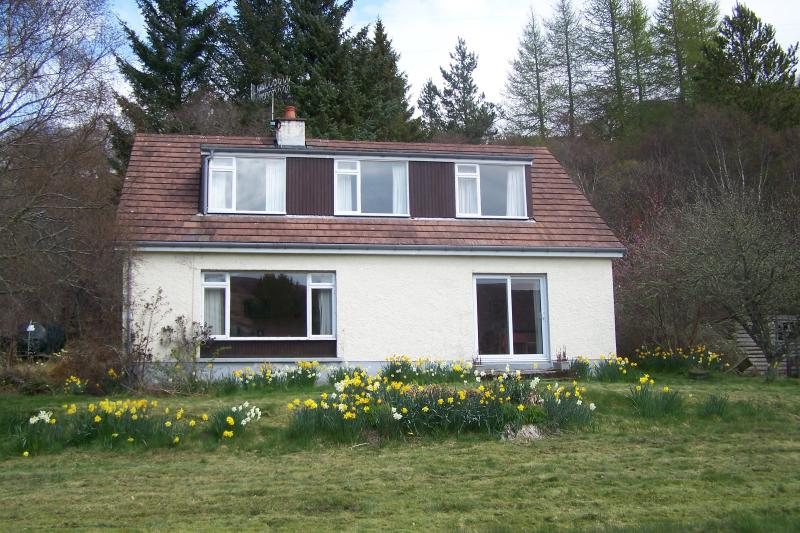 The modern house is situated in a wooded acre of its own grounds above falls on the Helmsdale River.