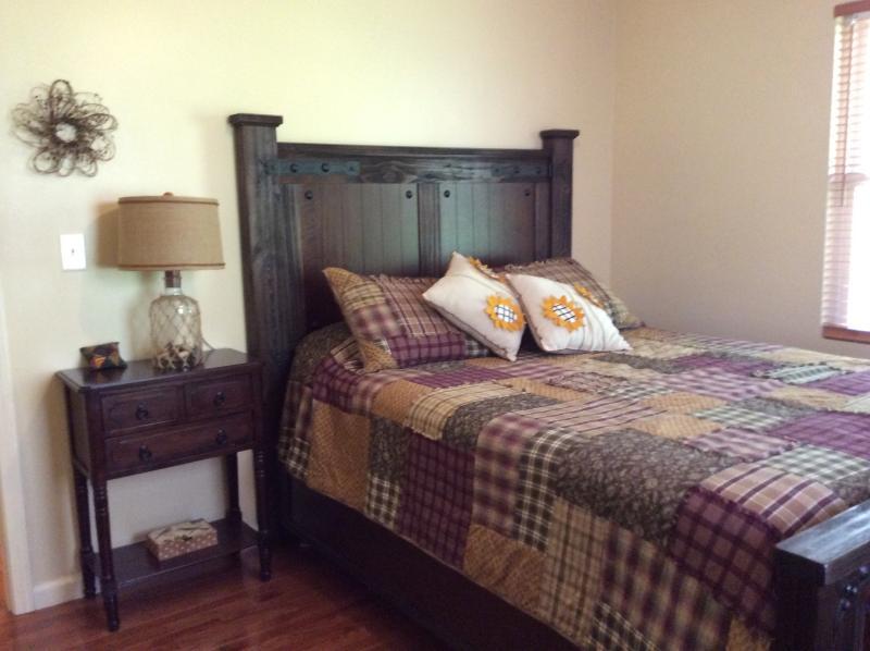 Guest bedroom with queen bed, creek sound with open window