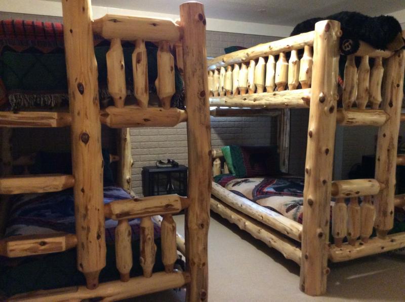 Bears Den, downstairs bedroom, cedar bunk beds, with connecting bathroom