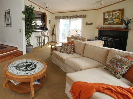 The spacious living room includes fireplace, stereo, and satellite TV.
