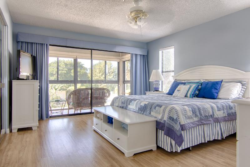 Master bedroom with direct entry to lanai for when you feel like watching the sunset in your PJs!