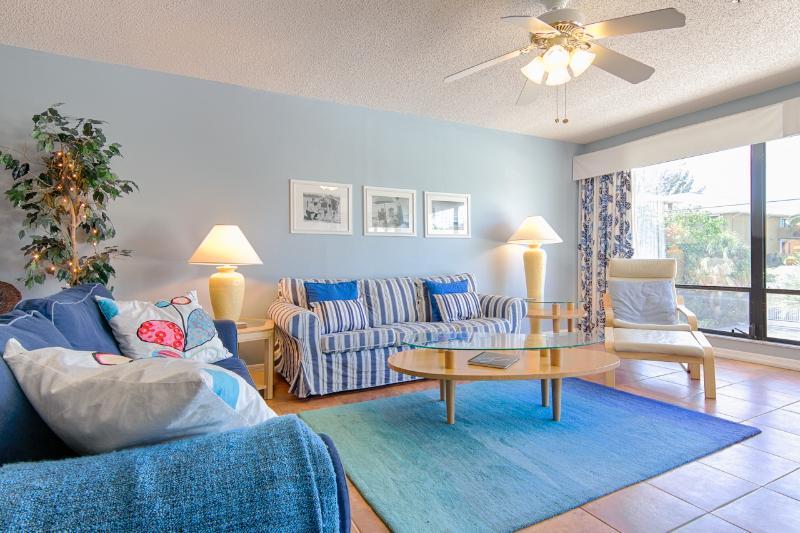 Comfy sofas in our AnnaMariaBeachCondo Tropical Sunset #2 unit.