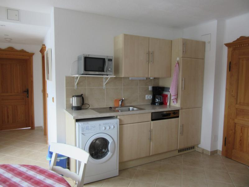 The kitchen is fully equipped, including  washing machine and dishwasher.